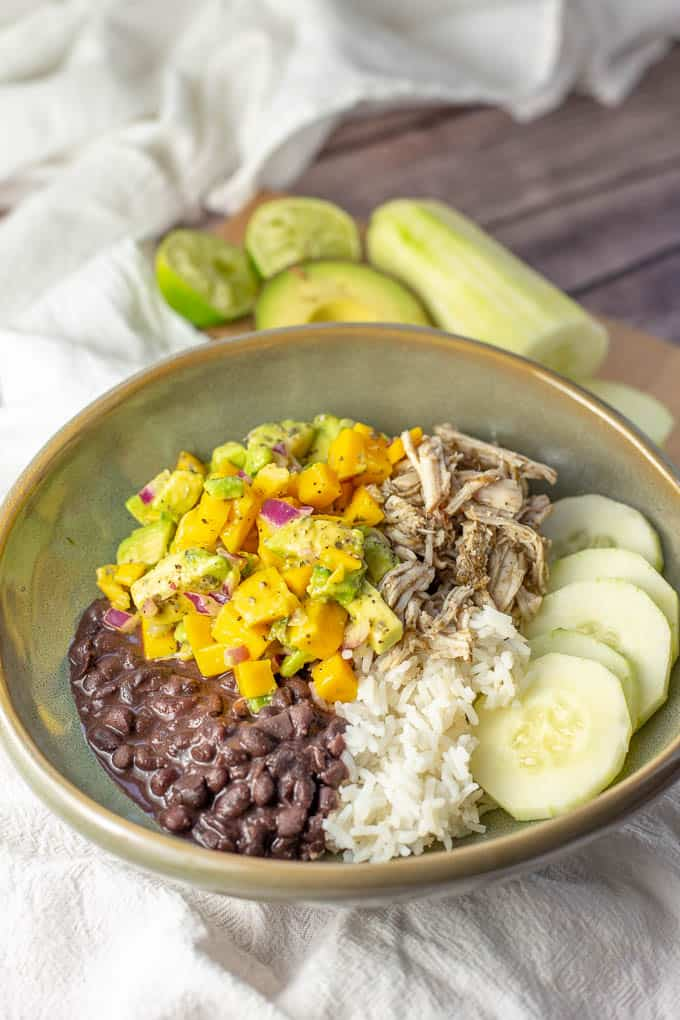 Easy Shredded Jerk Chicken with Mango Avocado Salsa can be made in a crockpot, stovetop, or instapot.