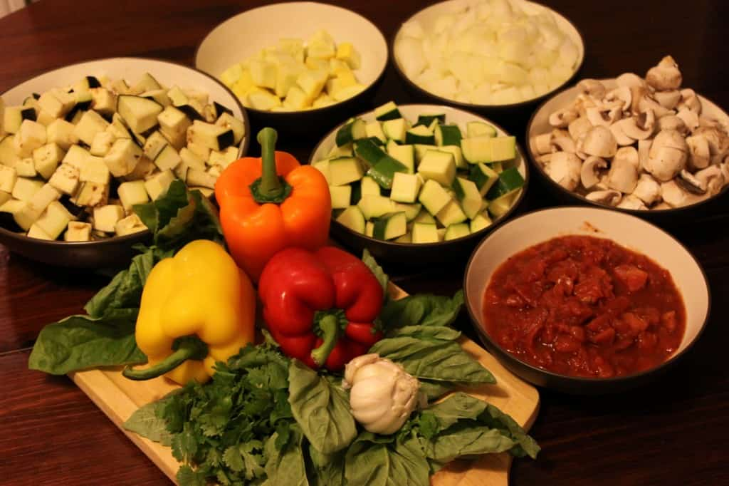 Prepping Eggplant, Mushrooms, Onion, Zucchini, Tomatoes, Squash, Peppers, and herbs for delicious ratatouille