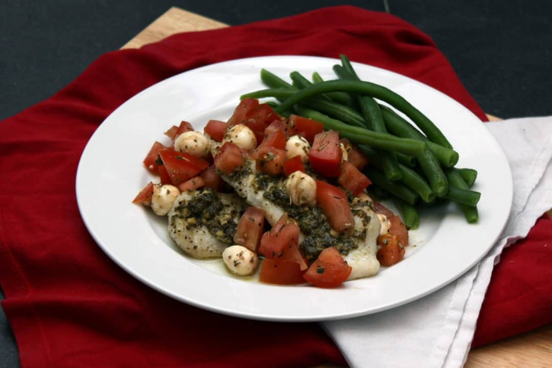 Caprese Tilapia: fish with tomatoes, mozzarella, and pestp