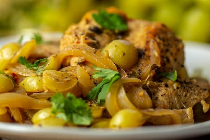 Intensely flavorful Spanish Cilantro chicken with grapes and white wine.