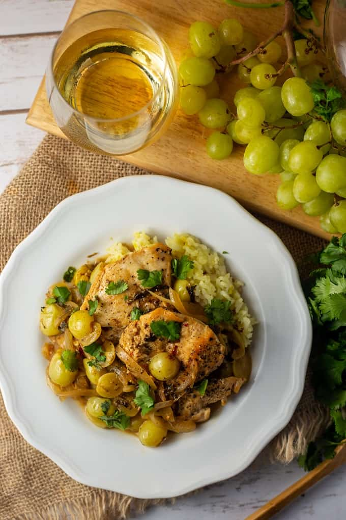 Make this simple Spanish chicken with grapes, cilantro, and white wine tonight