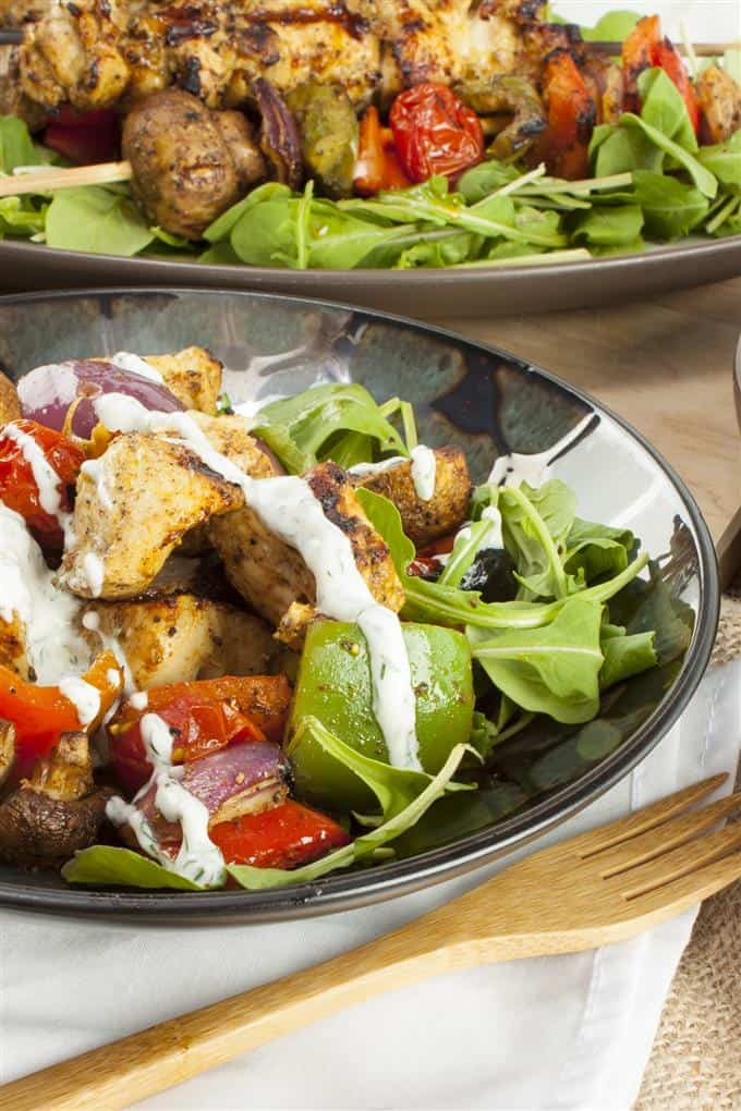 Grilled Moroccan chicken and vegetables on arugula with yogurt dill sauce