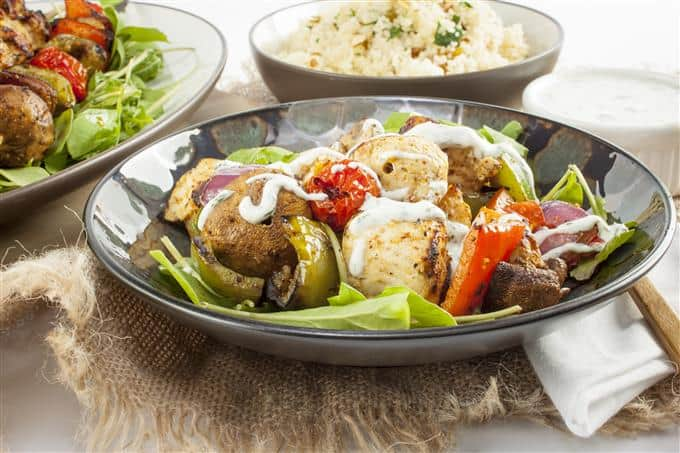 Moroccan-spiced grilled chicken and vegetables with yogurt dill sauce
