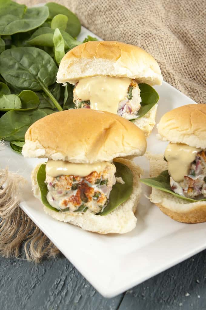 These salmon-crab sliders with zesty Creole mustard sauce are perfect for entertaining