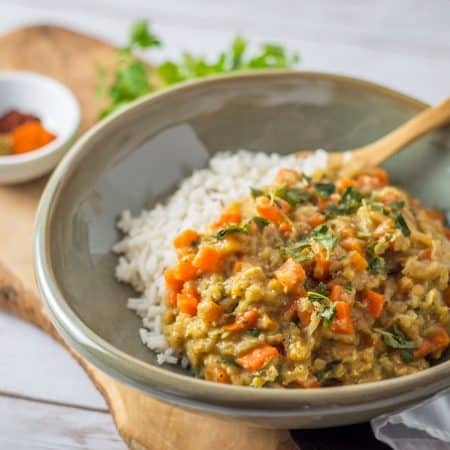 Spicy Carrot and Red Lentil Ragout served over rice.
